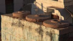 Historical old millstone grindstone on asia house wall In Jodphur, India Stock Footage