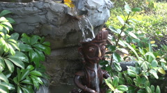 Decorative small fountain in buddhist temple garden Stock Footage