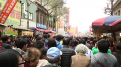 Crowd asian people in new year chinese go to The Buddhist Temple for Prayer -Dan Stock Footage