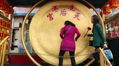 Stock Video Footage of Lugang Tianhou Temple,Asian People Strikes A Gong In A Buddhist Temple-Dan