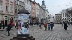 Lviv central square busy with pedestrians walking and tram riding Stock Footage