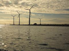 Wind turbines power generator farm in sea Kuvituskuvat