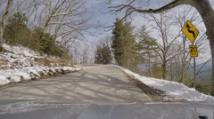 Curvy windy mountain road winter snow Stock Footage