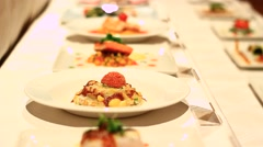 Professionally served food in rows Stock Footage