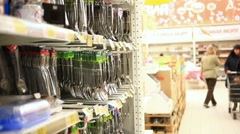 Woman shopping for Cutlery in retail store. Chooses cutlery and adds to Cart Stock Footage