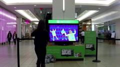 Microsoft xbox demonstrates dance game - stock footage