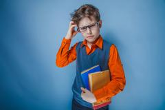 Boy teenager European appearance in retro clothes with books in Stock Photos