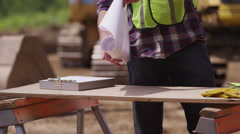 Construction workers looking at plans - stock footage