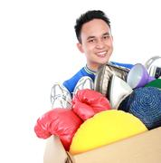 box full of goodies carried by young man - stock photo