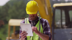Construction worker looking over plans Stock Footage