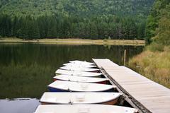 boats on the saint ana volcanic lake, romania - stock photo