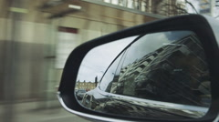 VIew of road in rearview mirror in car on road Stock Footage