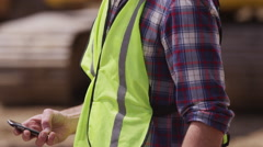 Construction worker talking on cell phone - stock footage