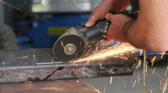 Side view of ginder creating sparks Stock Footage