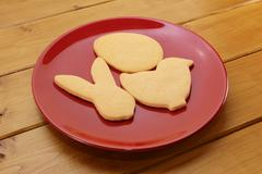 Cookies in egg, chick and rabbit shapes for Easter - stock photo
