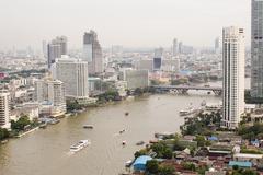 Top view ship on Chao Phraya river, bridge and city scape in Bangkok, Thailan Stock Photos