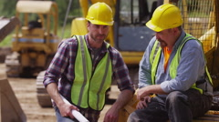 Portrait of two blue collar workers - stock footage