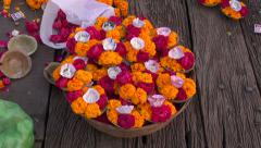 hinduism sacred puja ritual flowers in Varanasi on old wooden table, India - stock footage
