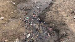 Polluted dirty open sewerage channel on Ganges river coast in Varanasi, India Stock Footage