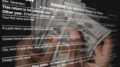 IRS Form (1040X) with Counting Money Background Stock Footage