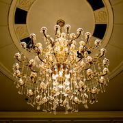 Classical crystal chandelier hanging on beautiful ceiling Kuvituskuvat