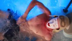 Mime in hot tub Stock Footage