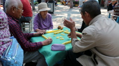 Chinese elderly playing Mahjong on the street Stock Footage