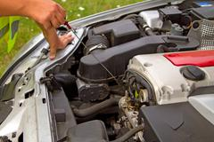 Checking engine oil Stock Photos