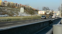 Road with cars - guardrail - buildings Stock Footage