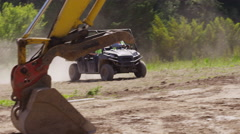 Construction workers driving utility vehicle on job site - stock footage