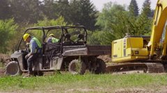 Workers get out of utility vehicle and walk to jobsite Stock Footage