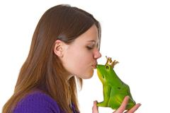 Beautiful woman with frog prince Stock Photos