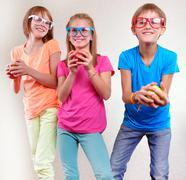 Group of funny kids with apples posing Stock Photos