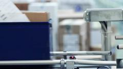 Cardboard boxes are weighed on a transporter of a packaging line - stock footage
