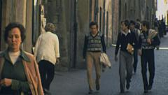 Orvieto, Italy 1977: people walking in the street Stock Footage