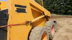 Construction worker driving excavation equipment - stock footage