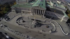 Camera flying above Austrian Parliament in Vienna. Stock Footage