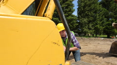 Worker inspecting excavtion equipment - stock footage