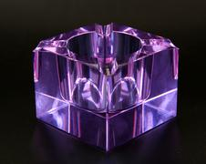 Glass ashtray blown of Murano amethyst color Stock Photos