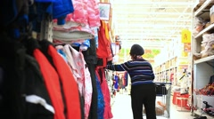 RUSSIA, 17 FEBRUARY, 2015. Fat woman looking clothes in a supermarket. HD Stock Footage