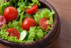 Spring healthy vegetarian salad with tomatoes and cucumber - stock photo