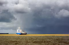 Cargo ship with stormy weather Stock Photos