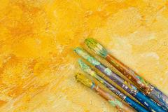 Artists vintage brushes on yellow artistic background Stock Photos