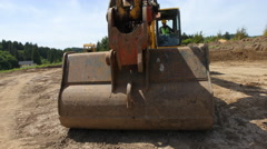 Construction workers work with excavation equipment - stock footage