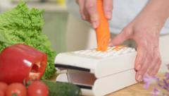 A carrot being grated Stock Footage