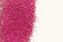 Pink glitter on light background - macro photo Stock Photos