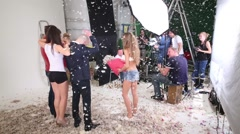 Shooting video clip of musical group Hello with many feathers Stock Footage