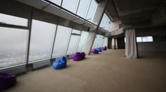 Indoor observation deck with glass wall in tall building Stock Footage