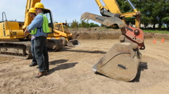 Construction workers meeting and talking on job site - stock footage