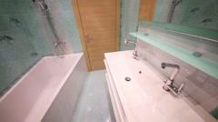 Empty bathroom in flat in residential complex Elk Island. Stock Footage